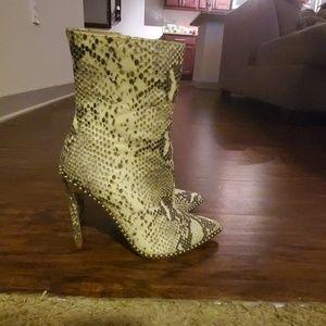 Trendy snakeskin boots